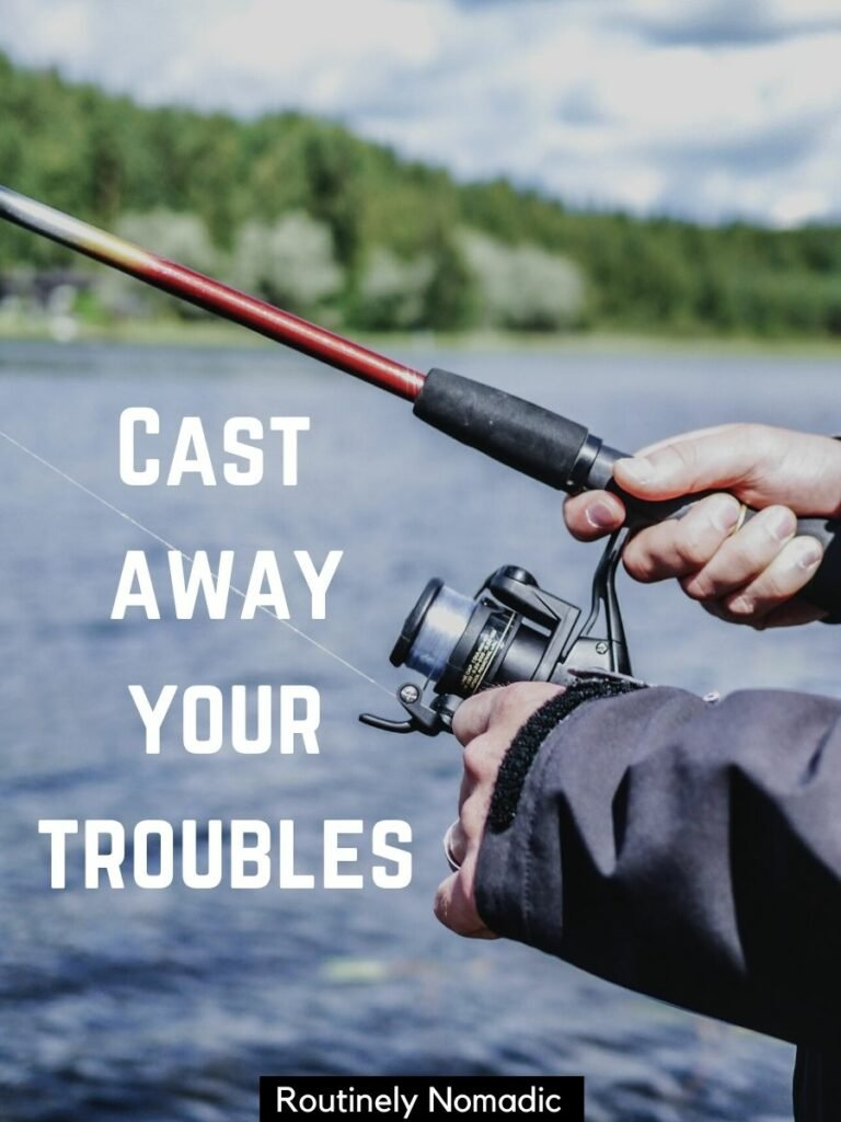 Hands holding a fishing rod on a lake with a good fishing captions that reads cast away your troubles