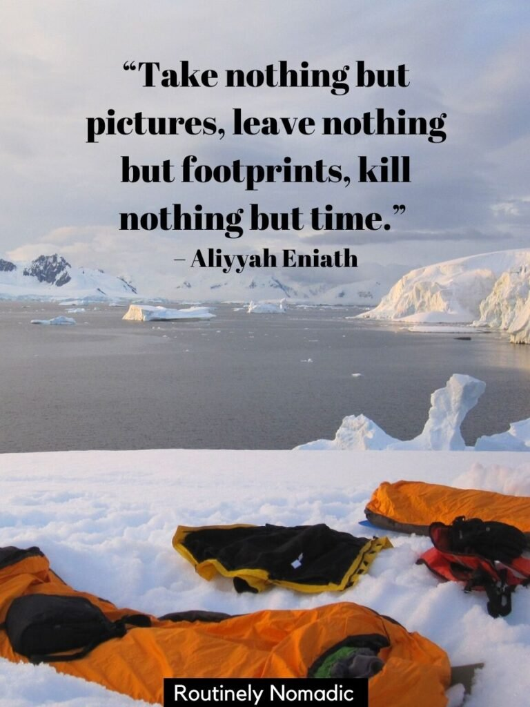 Bivy and sleeping bags on snow in Antarctica with a Inspirational quotes on camping