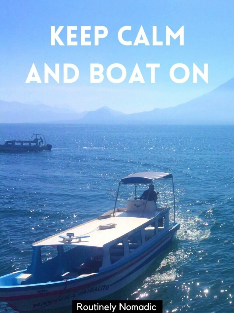 A boat on a lake with a volcano behind and a lake boat captions that reads keep calm and boat on