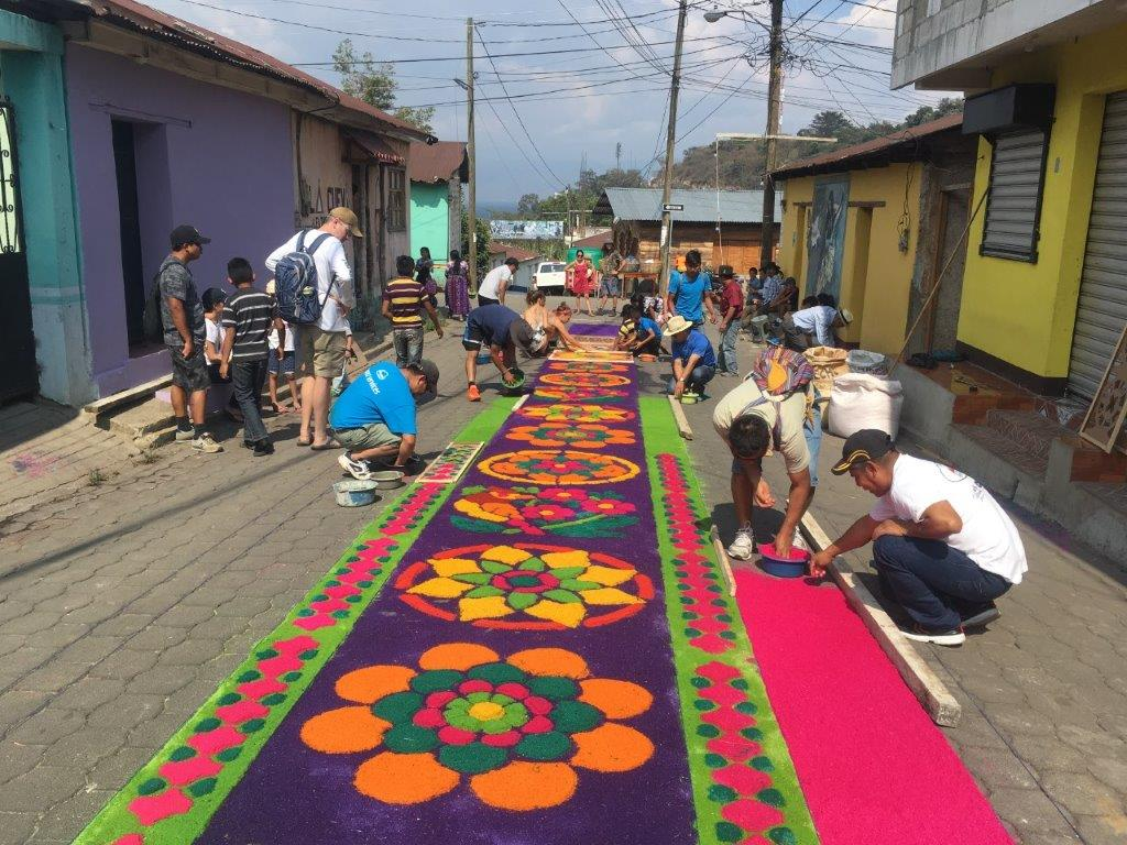Making the colorful alhumbras in San Juan la Laguna Guatemala during Semana Santa