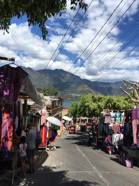 View down the road from the dock filled with San Juan la Laguna textiles shops