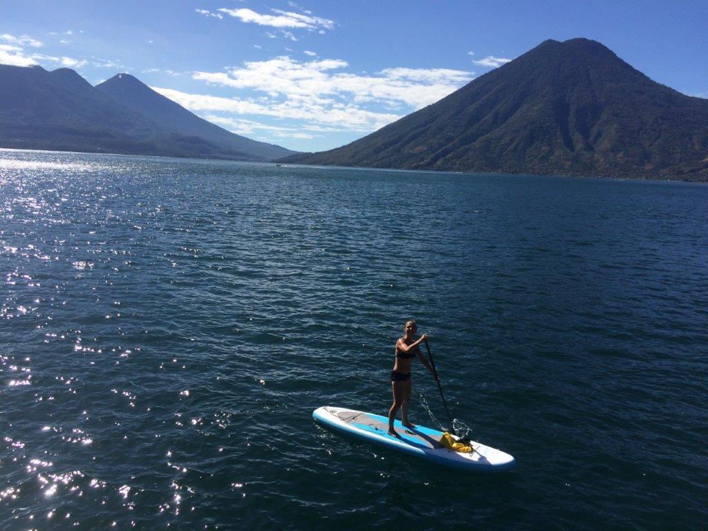 Paddleboarding on Lake Atitlan in front of volcanoes near San Marcos La Laguna Guatemala