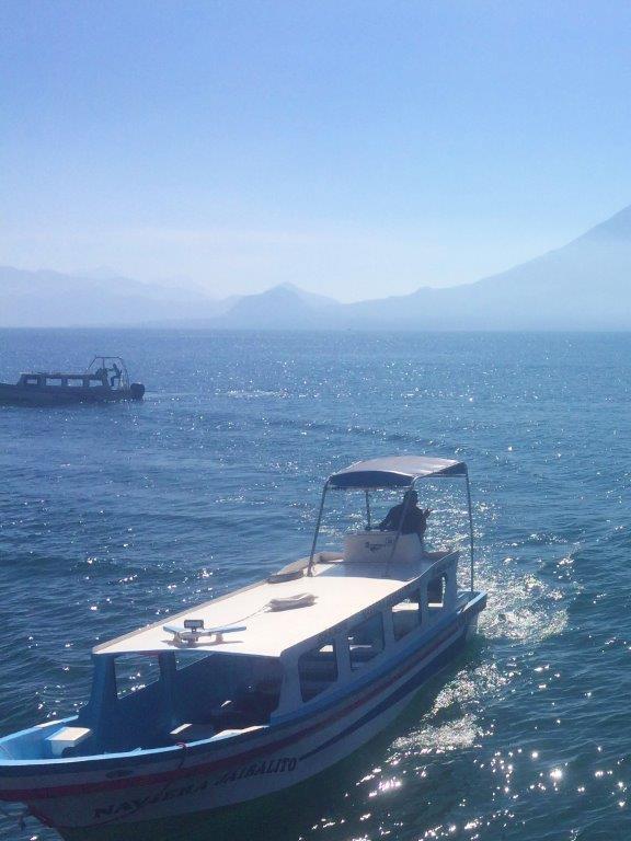 Boat pulling up to dock near San Marcos la Laguna