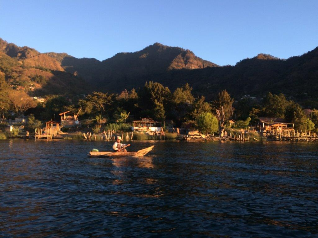 Fisherman in traditional canoe at San Marcos la Laguna in the early morning