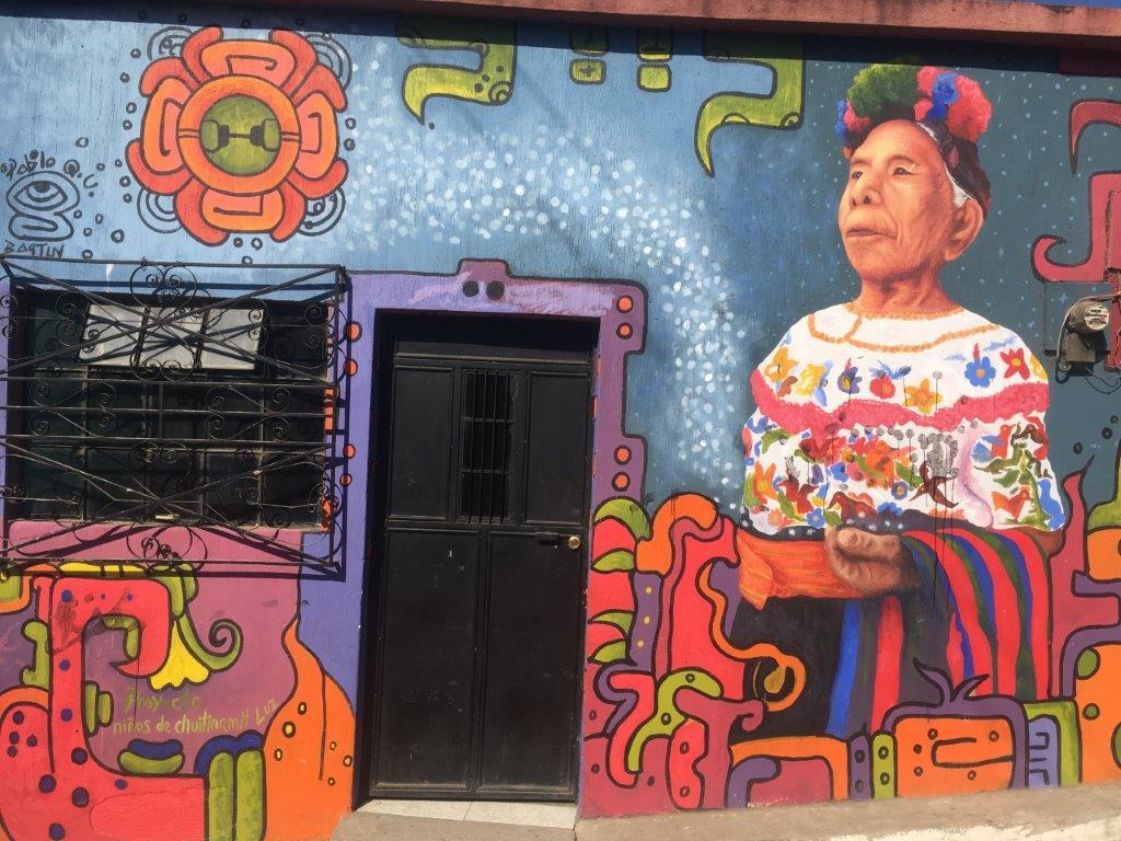 A colorful mural on a building in San Juan la Laguna Guatemala