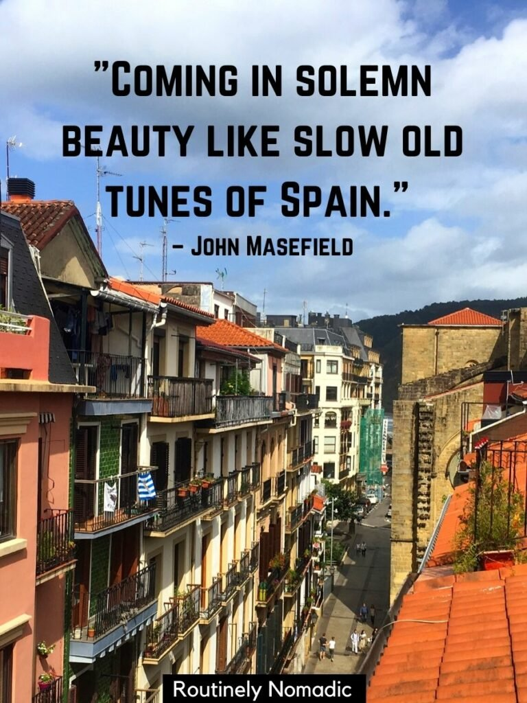 Narrow street from above with a short spain quotes for Instagram by John Masefield