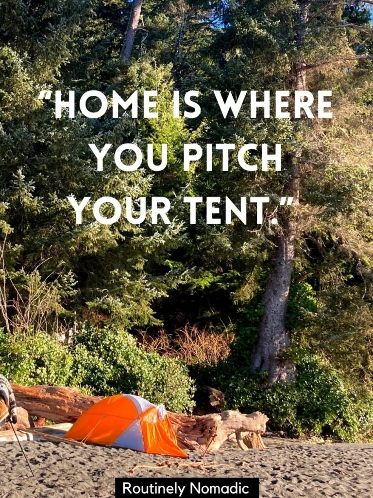 Tent on a beach with trees behind and a camping saying that reads home is where you pitch your tent