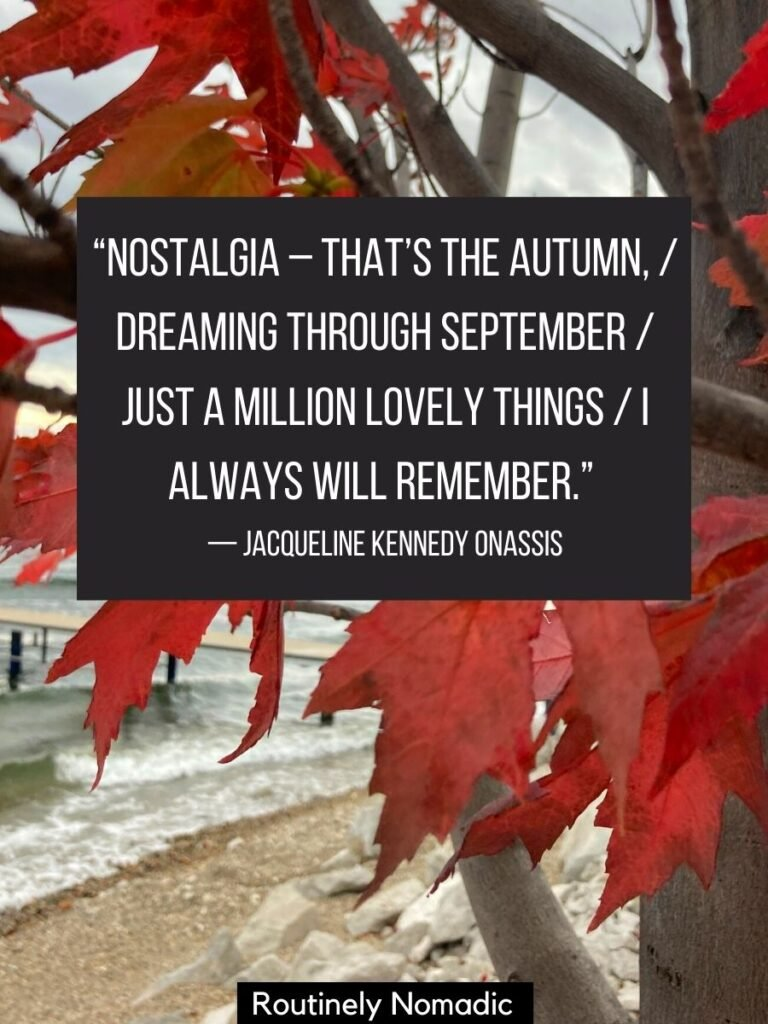 Closeup of red leaves with a autumn quotes by Jacqueline Onassis