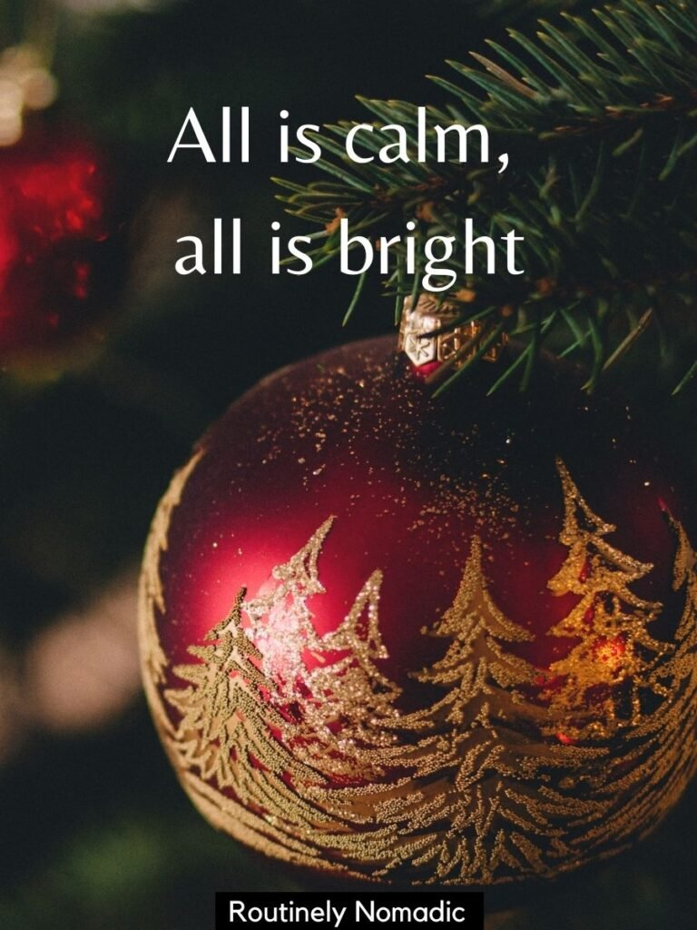 Christmas tree ornament with a Christmas captions that says All is calm, all is bright