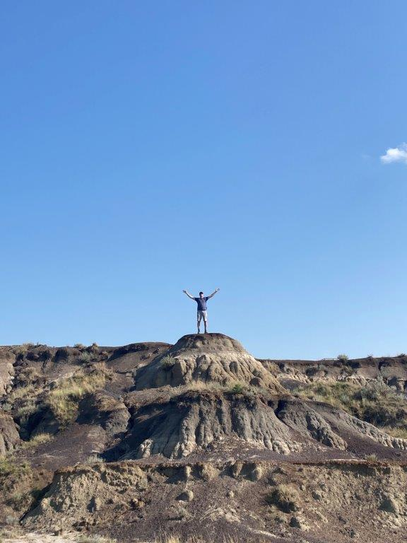 Man standing on hill in Horseshoe Canyon near Drumheller