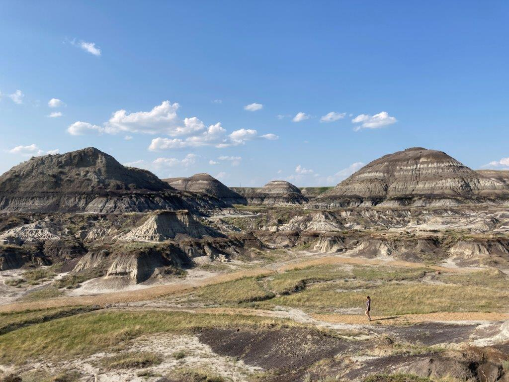 Person walking on the gravel trail on the Drumheller hike in Horseshoe Canyon