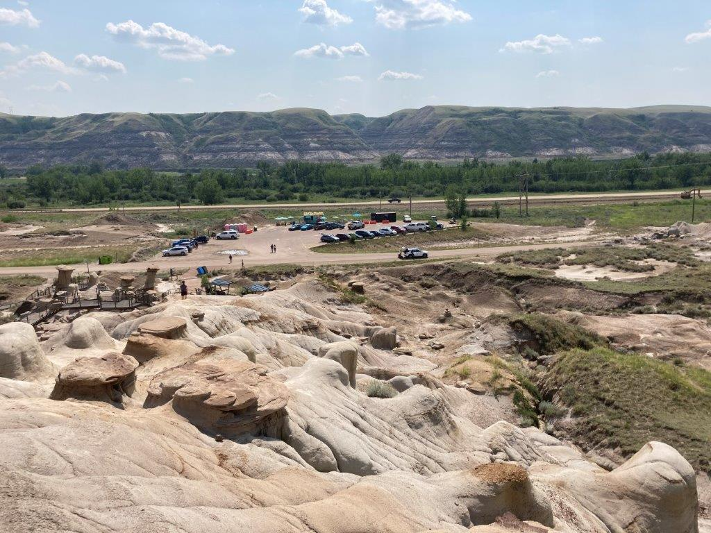 View of the Drumheller hoodoos from above and parking lot