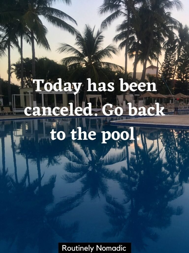 Palm trees reflected in a pool at sunrise with a funny pool captions that reads today has been canceled. Go back to the pool