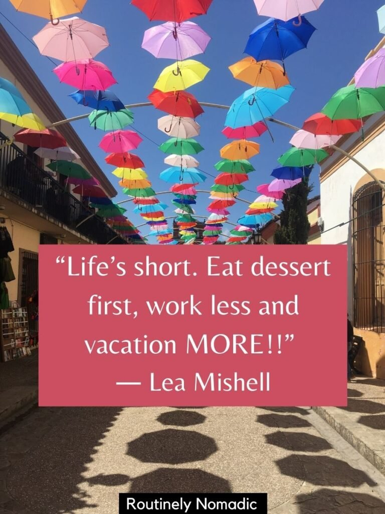 Umbrellas above a street with a funny vacation quotes by Lea Mishell