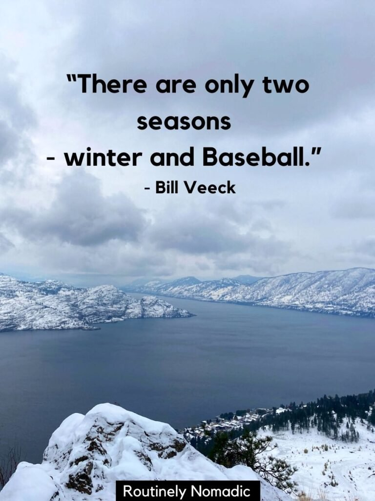 Snowy hills around a lake with funny winter quotes for Instagram by Bill Veeck