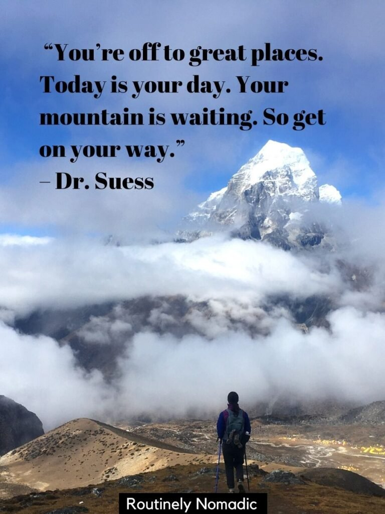 Person hiking towards mountain partially covered in clouds with a funny hiking quotes for Instagram by Dr Suess