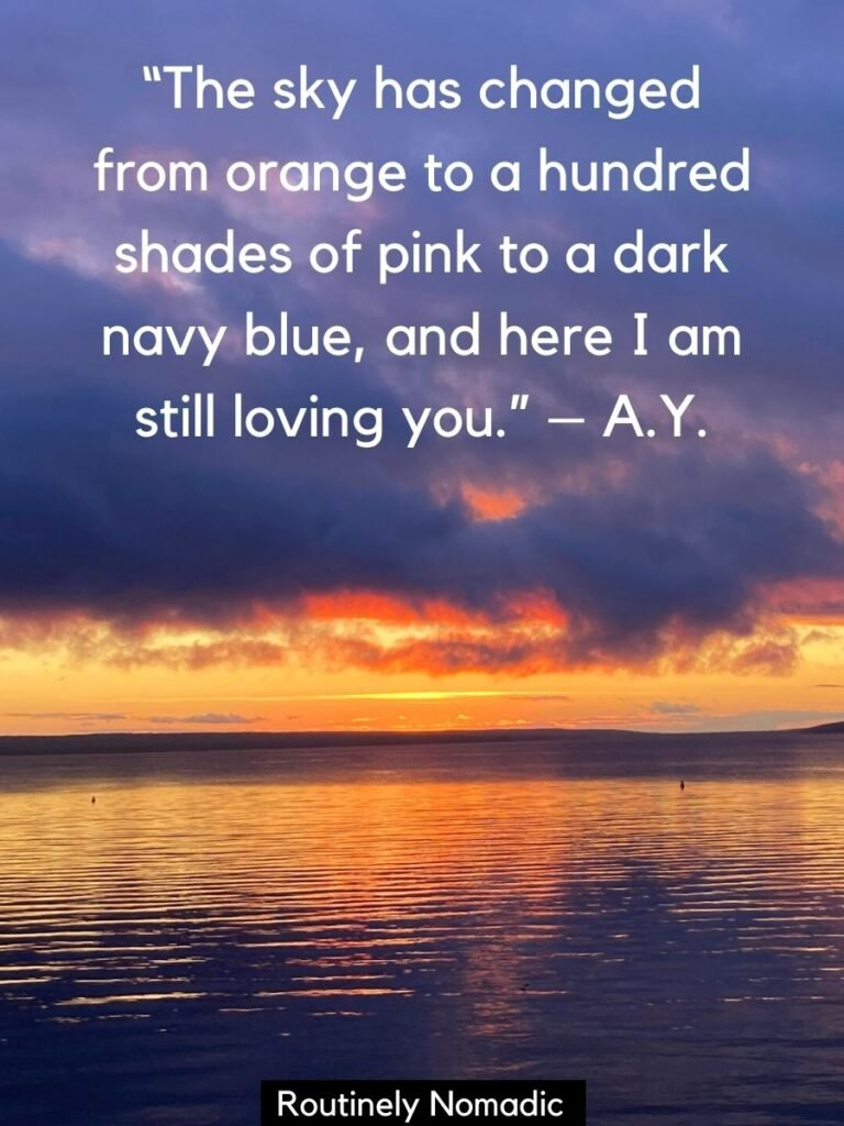 Sunset under dark clouds over a lake with love quotes sunset by A.Y.