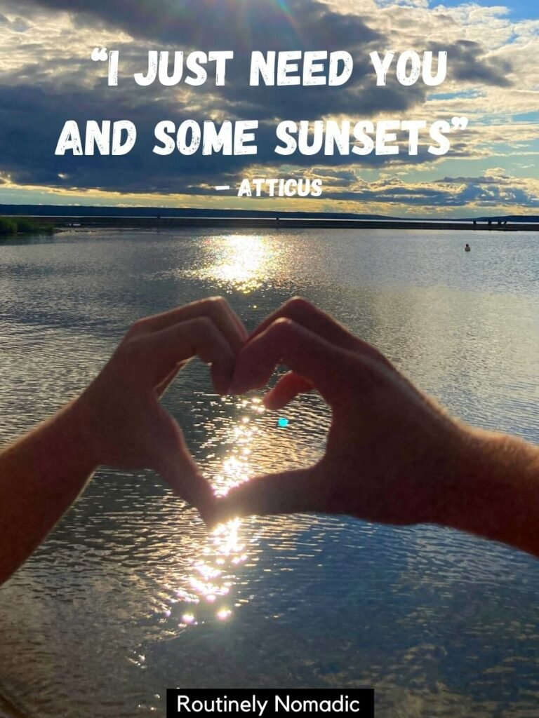 Two hands making a heart at sunset with a love sunset quotes by Atticus