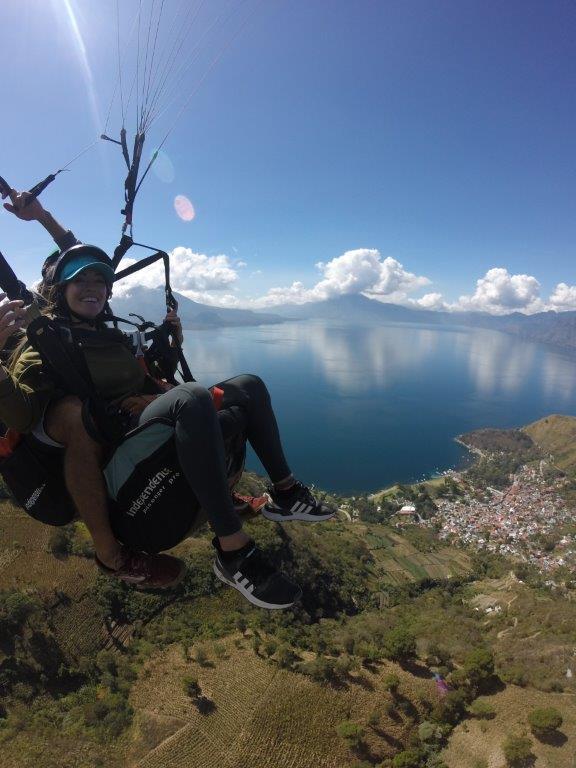 People paragliding above Lake Atitlan from Panajachel