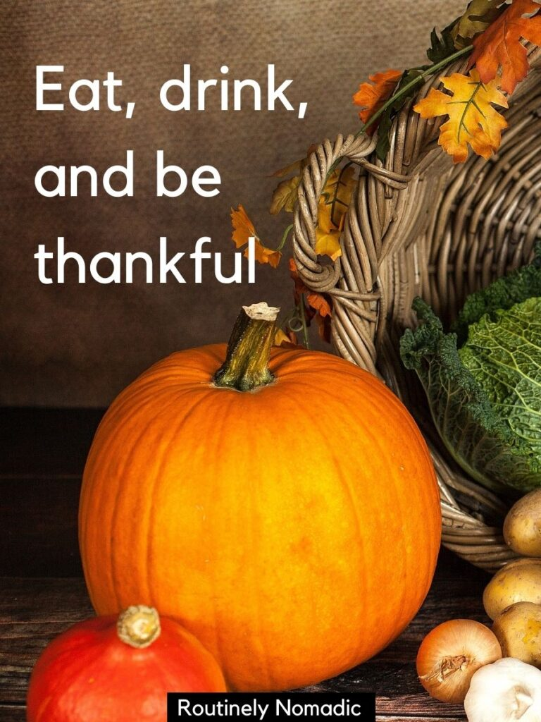 Pumpkins and veggies with a Thanksgiving captions that reads eat drink and be thankful