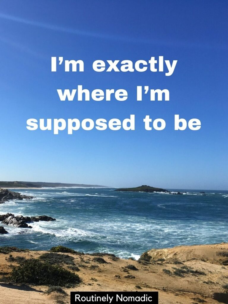 The ocean from a cliff with a vacation picture captions that says I'm exactly where i'm supposed to be