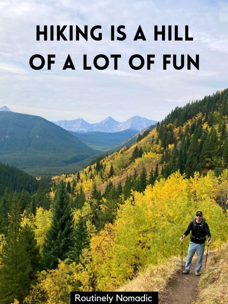 Man hiking up hill with fall trees and mountains behind and a hiking puns captions that reads hiking is a hill of a lot of fun