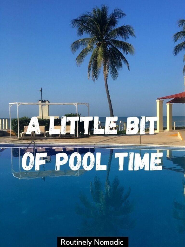 Palm tree reflected in a pool with a pool captions that reads a little bit of pool time