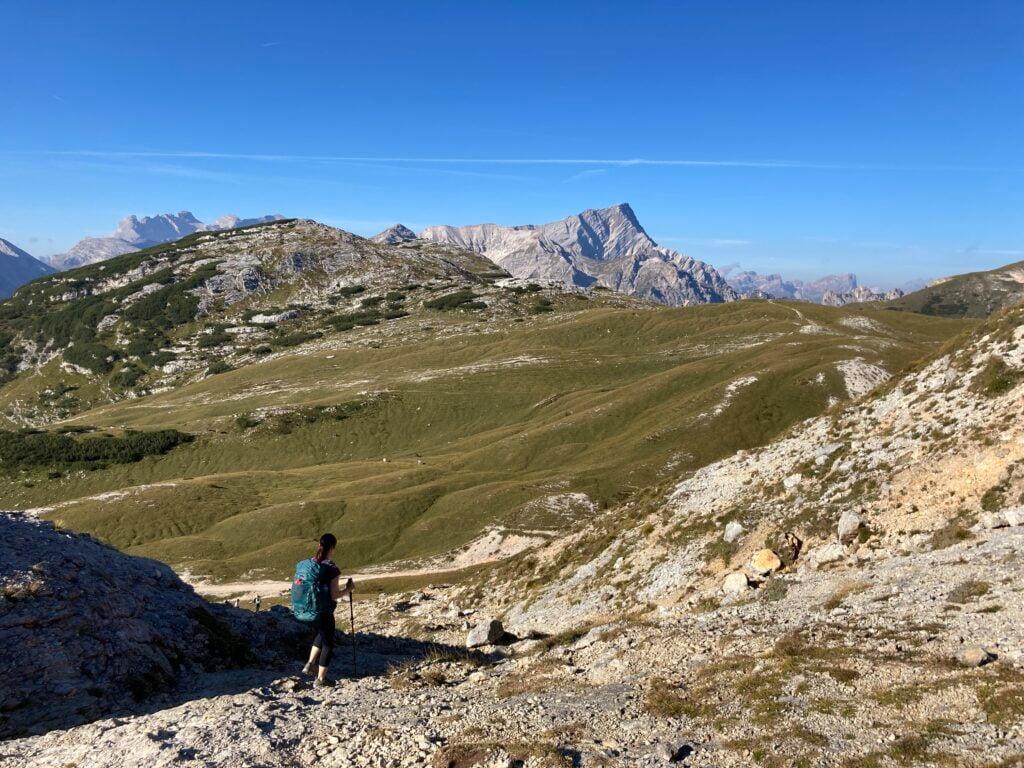 Woman hiking on rocky trail on the Alta Via 1 Dolomites