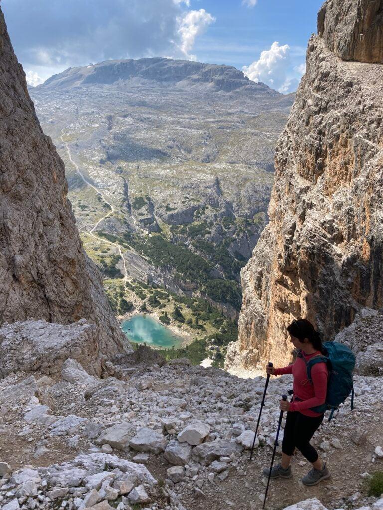 Person starting down steep trail to lake far below on Alta Via 1 blog