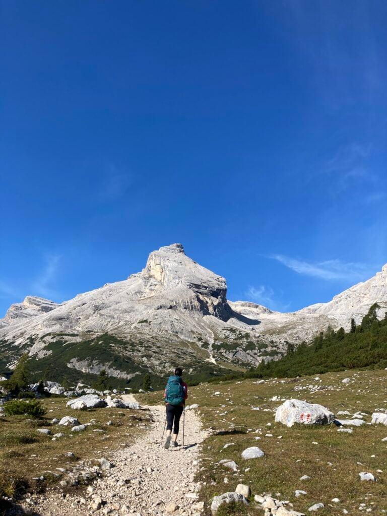 Hiker on rocky trail on Alta Via 1 Dolomites