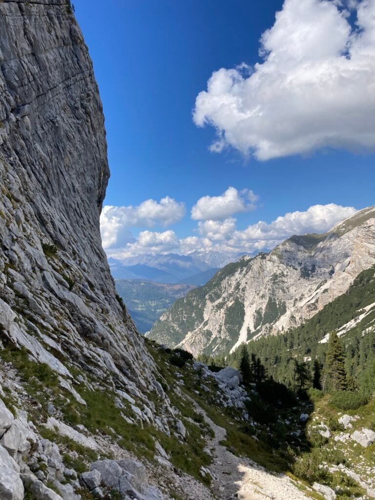 Trail on the Alta Via 1 Dolomites with a cliff on one side