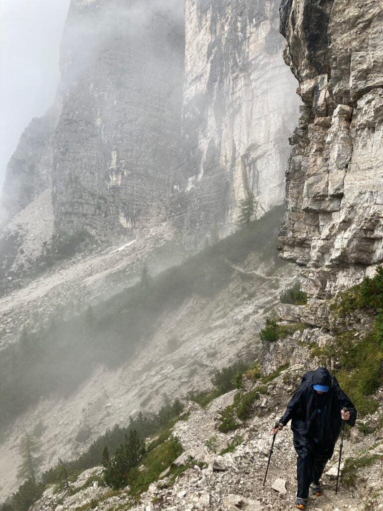 Person hiking in the rain on the Alta Via 1 Dolomites