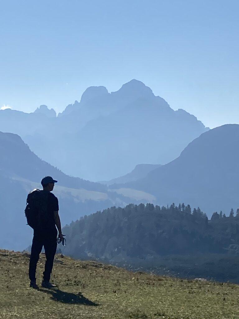 Man looking at mountains on the Alta Via 1 Dolomites