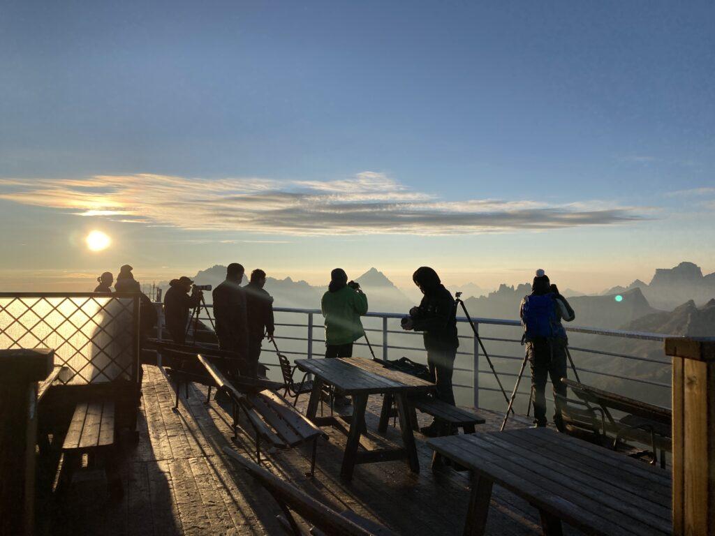 Photographers on deck at Alta Via 1 Rifugio Lagazuoi at sunrise