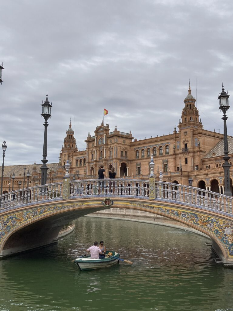 A couple in a rowboat at the Plaza de Espana a top Seville things to do