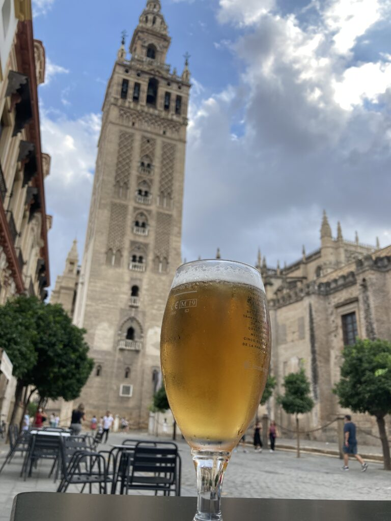 Glass of beer in front of the cathedral one of the best things to do in Seville Spain