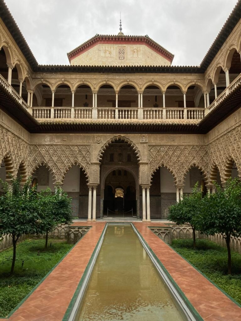 Real Alcazar building and pool what to do in Seville