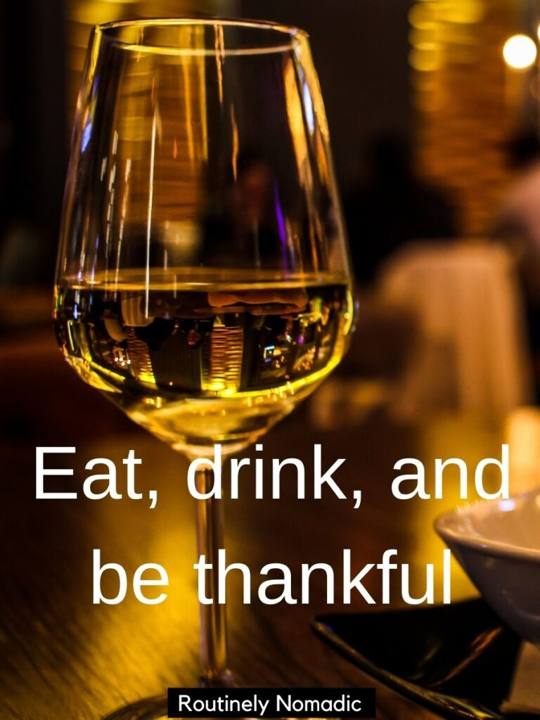 Wine glass with funny Thankful captions that says eat, drink and be thankful
