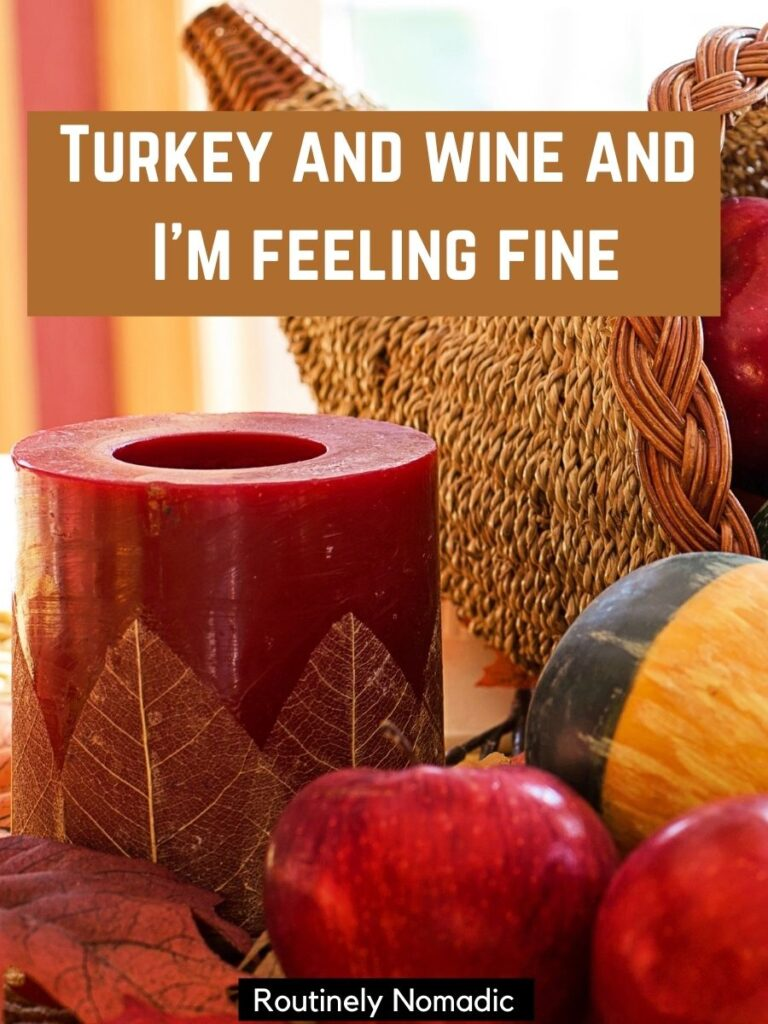 Candle, apples and a gourd with funny Thanksgiving Instagram captions that says turkey and wine and I'm feeling fine.