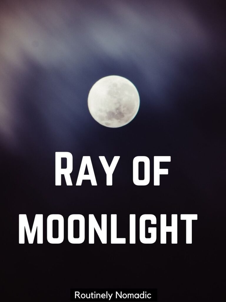 Moon and clouds with a moonlight captions that says ray of moonlight