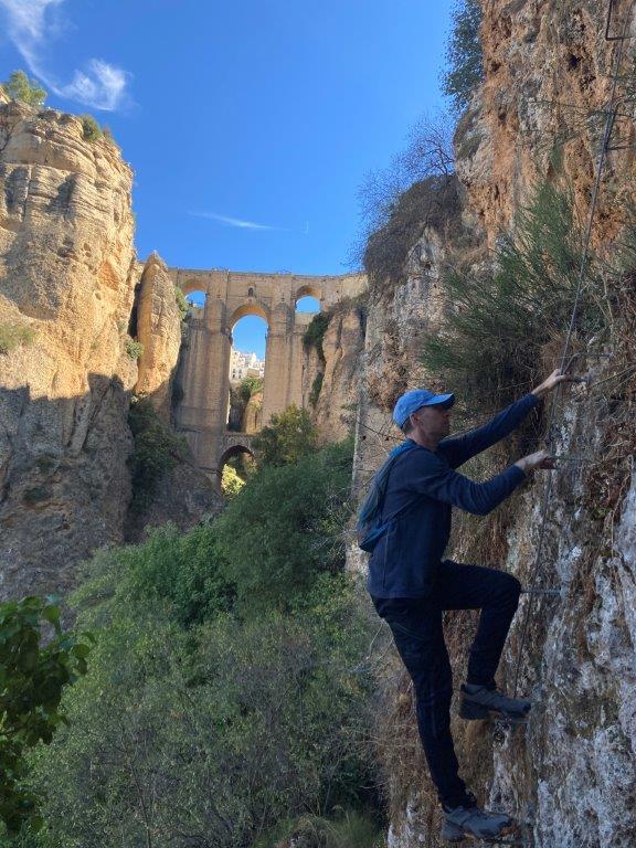 Man climbing Via Ferrata in Ronda Spain