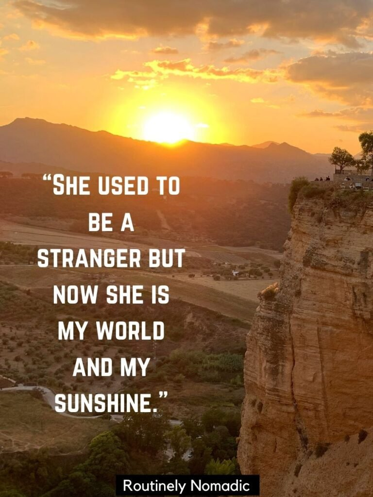 Sun setting behind ridge with a You are my sunshine quotes
